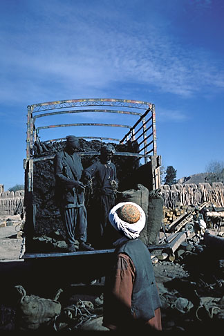 image 0-0-72 Afghanistan, Shoveling coal from truck, Herat