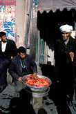 three people only stock photography | Afghanistan, Street scene with meat vendor, Herat, image id 0-0-93