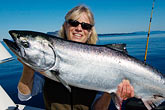 lady stock photography | Alaska, Kodiak, Fisherman and King Salmon, image id 5-650-4155