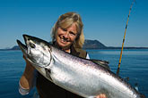 woman with water stock photography | Alaska, Kodiak, Fisherman with King salmon, image id 5-650-4160