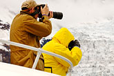 tour boat stock photography | Alaska, Prince WIlliam Sound, Photographers on tour boat, image id 5-650-446