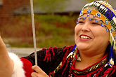alutiiq woman stock photography | Alaska, Anchorage, Raising the flag, image id 5-650-584