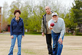 playing bocce on the town square stock photography | Alaska, Anchorage, Playing bocce on the town square, image id 5-650-666
