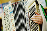 west stock photography | Alaska, Kodiak, Accordian player, image id 5-650-849