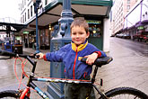 city stock photography | Alaska, Juneau, Young boy with bicycle, image id 7-189-14