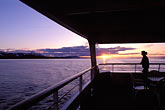 woman on boat stock photography | Alaska, Inside Passage, Sunset from cruise ship, image id 7-211-9