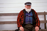 senior stock photography | Alaska, Petersburg, Old man seated on bench, image id 7-224-15