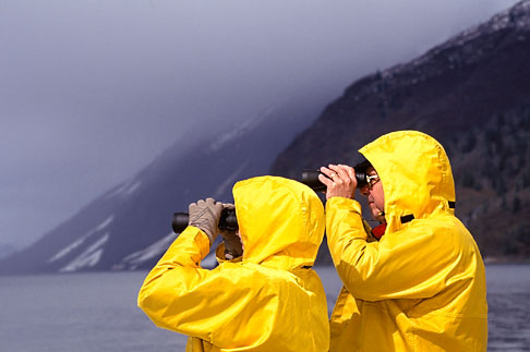 7-233-6  stock photo of Alaska, Inside Passage, Couple with binoculars, birdwatching