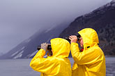 raincoat stock photography | Alaska, Inside Passage, Couple with binoculars, birdwatching, image id 7-233-6