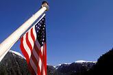 banner stock photography | Alaska, Misty Fjords National Monument, Flag and mountains, image id 7-239-4