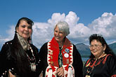 three people only stock photography | Alaska, Ketchikan, Tsimshian women with visitor, Metlakatla Island, image id 7-249-3