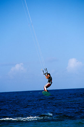 image 4-600-90 Antigua, Jabberwock Beach, Kiteboarder jumping