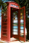 telephone box stock photography | Antigua, Dickenson Bay, Telephone booth and palms, image id 4-601-11