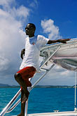 relaxing on a boat stock photography | Antigua, Man on Sailboat, image id 4-601-31