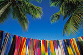 palms on the beach stock photography | Antigua, Jolly Harbor, Fabrics for sale on beach, image id 4-602-4