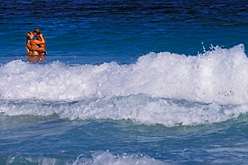 image 4-602-51 Antigua, Half Moon Beach, couple in surf