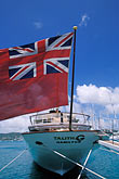 vertical stock photography | Antigua, English Harbor, Flag on boat in harbor, image id 4-603-55