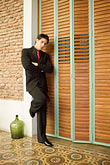 apparel stock photography | Argentina, Buenos Aires, Tango dancer, solo portrait, young man standing, image id S8-451-10471