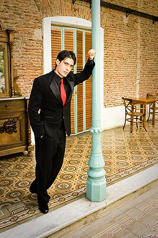 image S8-451-10478 Argentina, Buenos Aires, Tango dancer, solo portrait, young man leaning on post