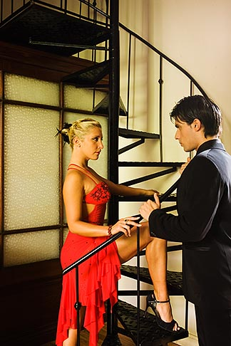 image S8-451-10587 Argentina, Buenos Aires, Tango dancers standing by spiral staircase
