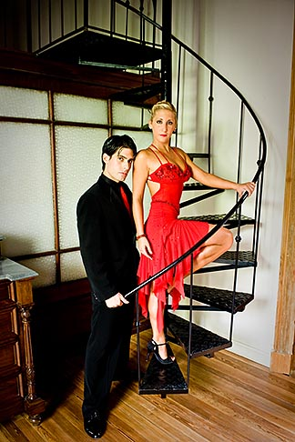 image S8-451-10591 Argentina, Buenos Aires, Tango dancers standing on spiral staircase
