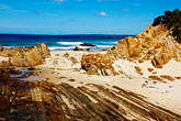 sand stock photography | Australia, Victoria, Mallacoota, Rock formations on beach, image id 5-600-1876