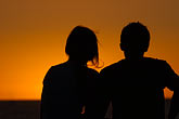 quiet stock photography | Australia, Couple watching sunset, silhouette, image id 5-600-9174