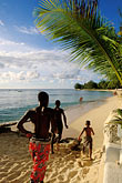 shore stock photography | Barbados, Holetown, Boys running on beach, image id 3-388-60