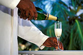 service server stock photography | Barbados, St. James, Man pouring champagne, image id 3-480-41