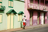 man on balcony stock photography | Barbados, Speightstown, Street scene, image id 3-481-44