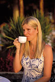 golden haired stock photography | Barbados, Holetown, Woman drinking tea, image id 3-490-51
