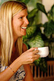 golden haired stock photography | Barbados, Holetown, Woman drinking tea, image id 3-490-53