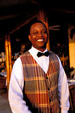 vertical stock photography | Barbados, Holetown, Hotel waiter, smiling, image id 3-490-58