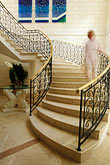 woman walking stock photography | Barbados, St. James, Sandy Lane hotel, stairway, image id 3-495-45