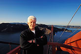 bay bridge stock photography | California, San Francisco, Dick Bunce of GGNPA on Golden Gate Bridge, image id 1-62-18