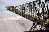 horizontal stock photography | California, San Francisco Bay, Salt manufacture, processed salt storage pile with conveyor, image id 1-770-49