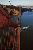 vertical stock photography | California, San Francisco, Golden Gate Bridge and ferry from South tower, image id 1-81-36