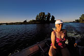 woman relaxing stock photography | California, Delta, Little Potato Slough, Boating at sunset, image id 1-856-42