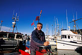 task stock photography | California, San Francisco Bay, Herring Fishermen, Ernie Koepf, captain of the Ursula B, image id 2-230-49