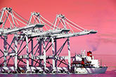 load stock photography | California, San Francisco Bay, Port of Oakland cranes arrive from China, image id 2-420-85