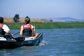 two people stock photography | California, East Bay Parks, Arrowhead Marsh, Oakland, Canoeing, image id 2-431-2