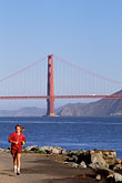vertical stock photography | California, San Francisco, Runner with Golden Gate Bridge, image id 3-189-33
