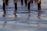 curved stock photography | California, Benicia, Wood pilings, waterfront, image id 4-245-16