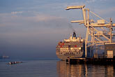 crane stock photography | California, Oakland, Container ship & rowers, Port of Oakland, image id 5-109-4
