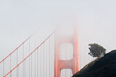 dawn stock photography | California, San Francisco Bay, Golden Gate Bridge in the fog, image id 5-740-72