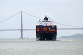horizontal stock photography | California, San Francisco Bay, Container ship and Bay Bridge, image id 6-440-5346