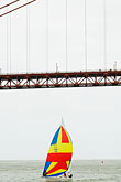 suspension bridge stock photography | California, San Francisco Bay, Sailboat under Golden Gate Bridge, image id 6-440-5385