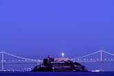 suspension bridge stock photography | California, San Francisco Bay, Alcatraz and Bay Bridge at night, image id 9-168-43