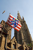 steeple stock photography | Belgium, Bruges, Church of Our Lady, Onze-Lieve-Vrouwekerk and Municipal flag of Bruges, image id 8-740-1152