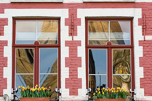 image 8-740-804 Belgium, Bruges, Window with flowerboxes and reflection of Belfry Tower